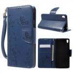Koženkové pouzdro Sony Xperia E5 - modré květy a motýli